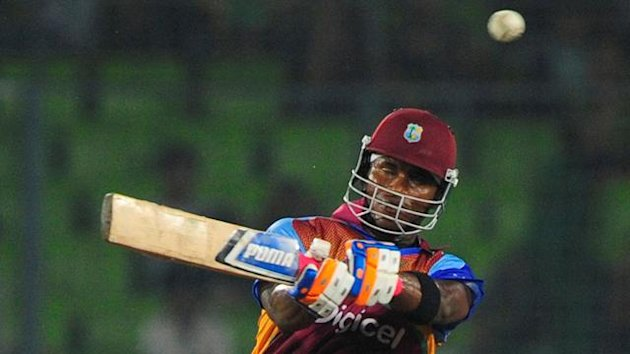 West Indies batsman Marlon Samuels plays a shot during the second one day international cricket match between Bangladesh and The West Indies at The Sher-e-Bangla National Cricket Stadium in Dhaka on October 15, 2011