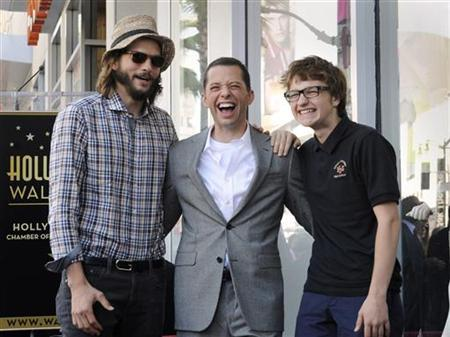 Cryer poses with co-stars Kutcher and Jones during a ceremony honoring Cryer with a star on the Hollywood Walk of Fame in Los Angeles