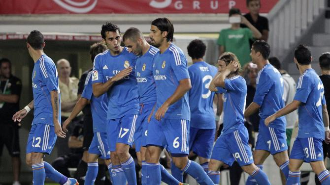 Real Madrid's players celebrate after they scored against Elche during their Spanish first division match in Elche