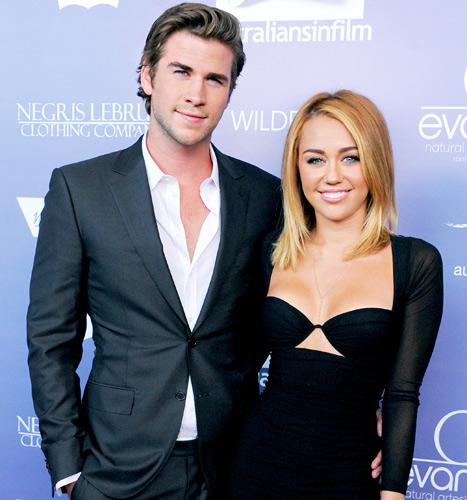 """Miley Cyrus, Liam Hemsworth Reunite in L.A., Are """"Happy"""" Together"""