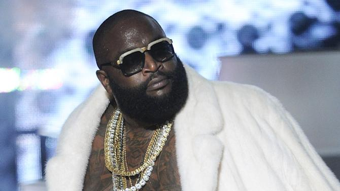 FILE - This Sept. 29, 2012 file photo shows Rick Ross performing at the BET Hip-Hop Honors at Boisfeuillet Jones Atlanta Civic Center, in Atlanta. Lil Wayne and Ross, two of the most celebrated and successful artists in rap today, recently lost major endorsements after protests forced high profile corporations to drop the rap stars. Both artists rapped lyrics deemed vulgar and over-the-top; one referring to rape, the other about the beating of Emmett Till, on songs where they were the featured acts. (Photo by John Amis/Invision/AP, file)
