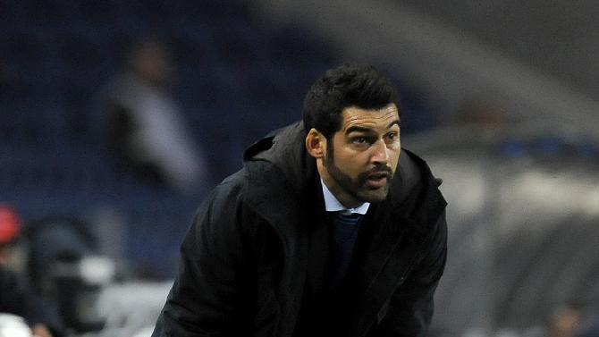 Porto's coach Paulo Fonseca catches a ball on the touchline during the Champions League group G soccer match between FC Porto and Austria Vienna Tuesday, Nov. 26, 2013, at the Dragao stadium in Porto, northern Portugal. The match ended in a 1-1 draw