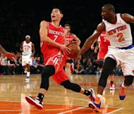Jeremy Lin of the Houston Rockets heads for the net as Raymond Felton of the New York Knicks defends on December 17, 2012 at Madison Square Garden in New York City. Lin finished with 22 points and eight assists as Houston beat the Knicks 109-96, handing his former team their first home loss of the season