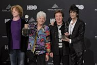 Small Faces/Faces members Ian McLagan, second from left, Kenney Jones, and Ronnie Wood, right, appear in the press room with Simply Red lead singer Mick Hucknall left, after induction into the Rock and Roll Hall of Fame Rock and Roll Hall of Fame Friday, April 13, 2012, in Cleveland. Hucknall subbed for Faces member Rod Stewart who was ill. (AP Photo/Amy Sancetta)
