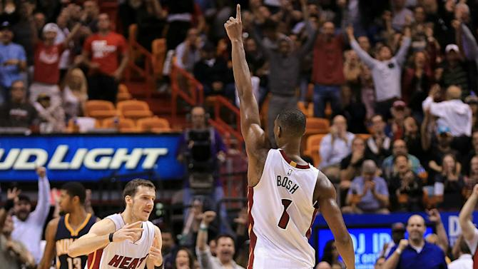 Chris Bosh lashes out at Heat, vows NBA return