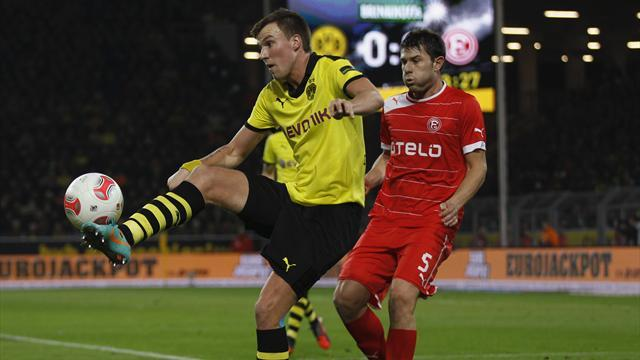 German Bundesliga  - Dortmund held by Fortuna, Schalke lose