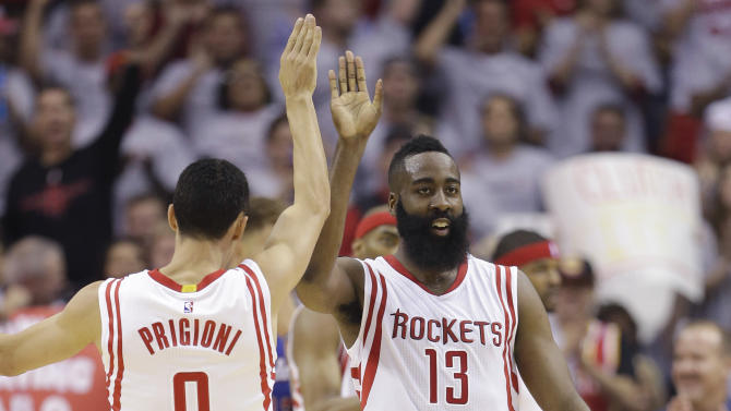 Houston Rockets' James Harden (13) celebrates with teammate Pablo Prigioni (9) during the first half of Game 1 in a second-round NBA basketball playoff series against the Los Angeles Clippers, Monday, May 4, 2015, in Houston. (AP Photo/David J. Phillip)