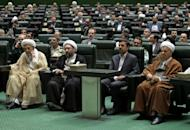 "(L-R) Iran's head of Assembly of Experts Mohammad Reza Mahdavi Kani, judiciary chief Sadeq Larijani, President Mahmoud Ahmadinejad and former president Akbar Hashemi Rafsanjani attend the opening session of Iran's new parliament in Tehran on May 27. Ahmadinejad insisted Wednesday enriching uranium to 20 percent ""is our right"" and not a step towards a bomb"