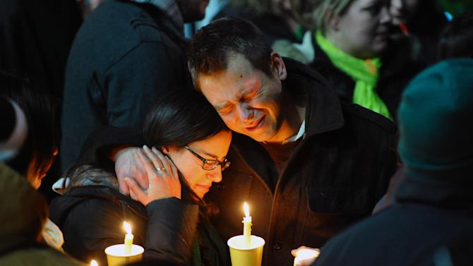 Ted Kowalczuk, of Milford, Conn., and his friend Rachel Schiavone, of Norwalk, Conn., attend a candlelight vigil held behind Stratford High School on the Town Hall Green in Stratford, Conn. on Saturday December 15, 2012. Kowalczuk and Schiavone were close friends to Stratford High graduate Vicki Soto, who was killed in yesterday's mass shooting at Sandy Hook Elementary School in Newtown. Soto was a teacher at the school.(AP Photo/The Connecticut Post, Christian Abraham) MANDATORY CREDIT