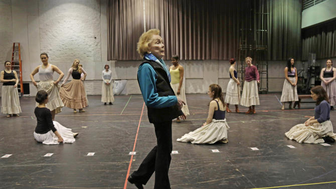 "In this April 26, 2013 photo, choreographer Gemze de Lappe confers with the pianist during a rehearsal of Rodgers and Hammerstein's ""Oklahoma!"" at the Lyric Opera of Chicago. De Lappe first danced in ""Oklahoma!"" in 1943 as a member of the Broadway hit's first national touring company and now 70 years later at age 91 she's choreographing a production of the musical at the Lyric. (AP Photo/M. Spencer Green)"