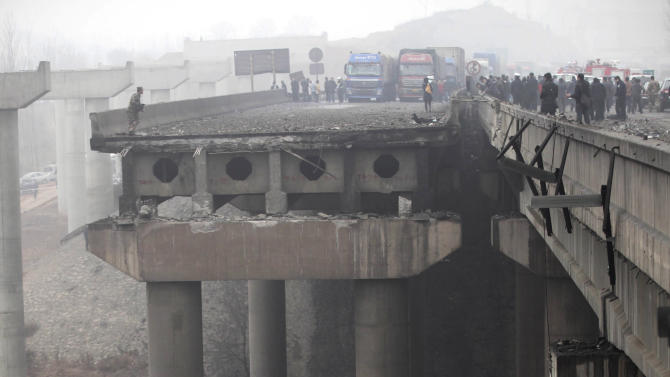 Rescuers work at the accident site where an expressway bridge partially collapsed due to a truck explosion in Mianchi County, Sanmenxia, central China's Henan Province, Thursday, Feb. 1, 2013. Fireworks for Lunar New Year celebrations exploded on a truck in central China, destroying part of an elevated highway Friday and sending vehicles plummeting 30 meters (about 100 feet) to the ground. State media had conflicting reports on casualties. (AP Photo)