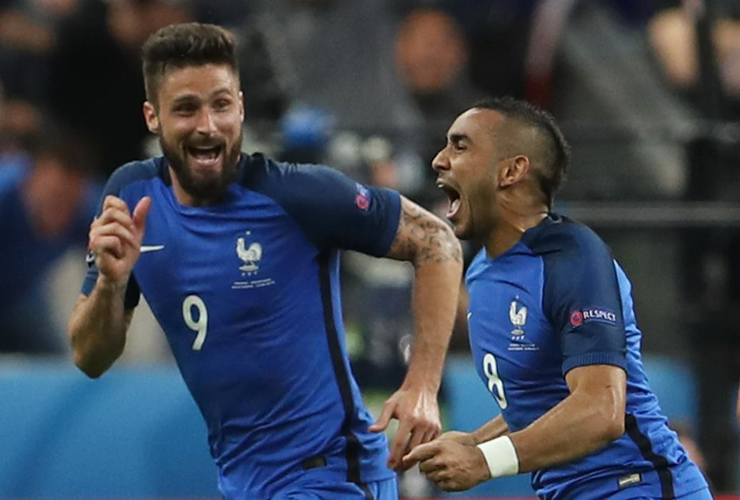 France's Dimitri Payet celebrates after scoring their second goal with Olivier Giroud