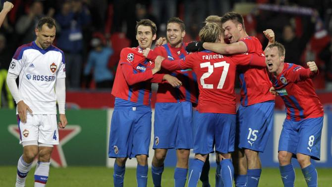 CSKA Moscow's Sergei Ignashevich walks past Viktoria Plzen's players celebrating after their Champions League soccer match in Plzen