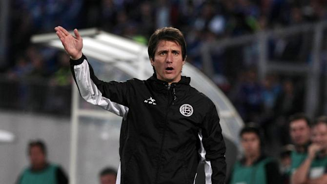 Coach of Argentina's Lanus Guillermo Barros Schelotto gestures during a Copa Sudamericana soccer match with Chile's Universidad de Chile in Santiago, Chile, Wednesday, Sept. 25, 2013