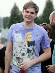 "Grant Mayland of Minneapolis wears a shirt decorated with cats while he waits for the start of the Walker Art Center's first ""Internet Cat Video Film Festival,"" showcasing the best of cat films on the Internet in Minneapolis Thursday, Aug. 30, 2012. The Walker Art Center in Minneapolis held its first-ever online cat video festival, a compilation of silly cat clips that have become an Internet phenomenon, attracting millions of viewers for some of the videos. (AP Photo/Craig Lassig)"