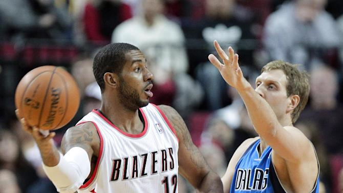Portland Trail Blazers forward LaMarcus Aldridge, left, looks to pass against Dallas Mavericks forward Dirk Nowitzki, from Germany, during the first half of an NBA basketball game in Portland, Ore., Saturday, Dec. 7, 2013