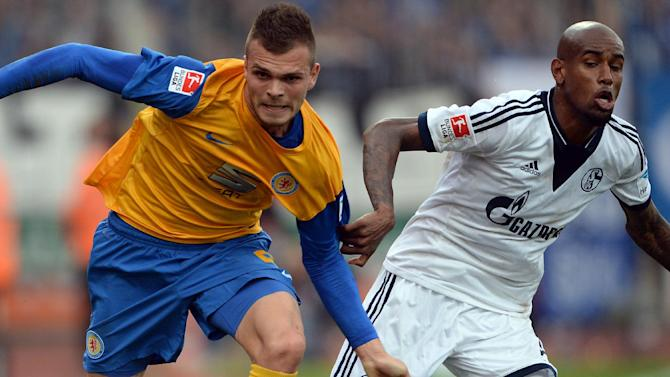 Braunschweig's Orhan Ademi, left, and Schalke's Felipe Santana challenge for the ball during the German first division Bundesliga soccer match between Eintracht Braunschweig and FC Schalke 04 in Braunschweig, Germany, Saturday, Oct. 19, 2013