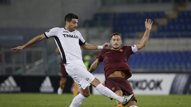 Roma's Francesco Totti in action with FC Astra Giurgiu's Daniel Niculae