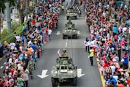 Tanks participate in the parade and procession in conjunction with the Merdeka Day celebrations at Dataran Merdeka, Kuala Lumpur August 31, 2014. — Picture by Saw Siow Feng