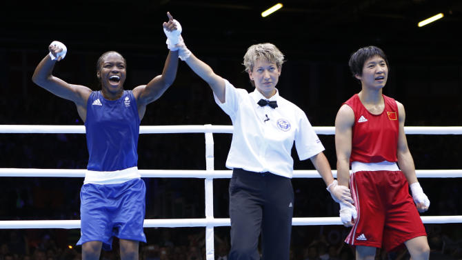 Britain's Nicola Adams reacts as she is declared the winner over China's Ren Cancan during their Women's Fly (51kg) gold medal boxing match at the London Olympic Games