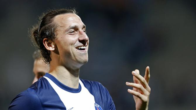 Paris Saint Germain's Ibrahimovic celebrates after his team won their French Ligue 1 soccer match 2-1 against Olympique Marseille in Marseille