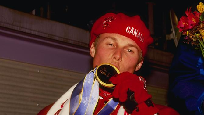 FILE - Ross Rebagliati of Canada kisses his gold medal during the snowboard medal ceremony during the 1998 Winter Olympic Games in Nagano, Japan. Rebagliati later was tested for marijuana and was disqualified and lost his gold medal.