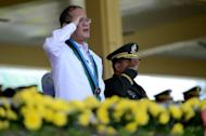 Philippine President Benigno Aquino (L) salutes to the soldiers on parade during the 77th anniversary celebrations of the Armed Forces of the Philippines at the Camp Aguinaldo in Manila, on December 21, 2012. Aquino may continue to carry a gun despite an impending ban on bearing firearms in the run-up to polls, according to an election official