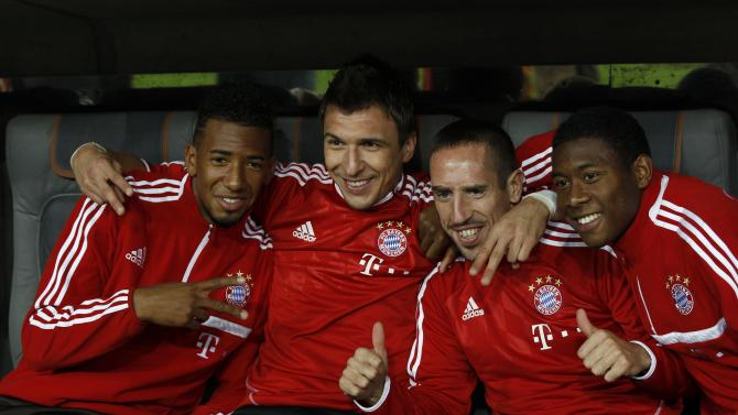 Bayern Munich's Boateng Mandzukic Ribery and Alaba pose before German soccer cup match against Hanover 96 in Munich