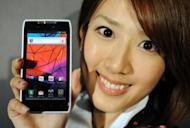 A model holds Motorola Mobility's new smartphone, Motorola Razr, at an event in Tokyo in March 2012. Google Tuesday finalized its $12.5 billion deal for Motorola Mobility, a key manufacturer of smartphones and other devices which puts the Internet giant in head-to-head competition with Apple