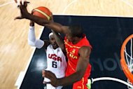 Serge Ibaka (R) of Spain defends against LeBron James (L) of the US during the London 2012 Olympic Games men's gold medal basketball game between USA and Spain at the North Greenwich Arena in London