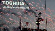 A Toshiba logo is displayed outside an electrical shop in Tokyo. Toshiba said Tuesday it would build a new chip factory in Thailand to replace one hit by record flooding last year that hammered Japanese manufacturers operating in the Southeast Asian nation
