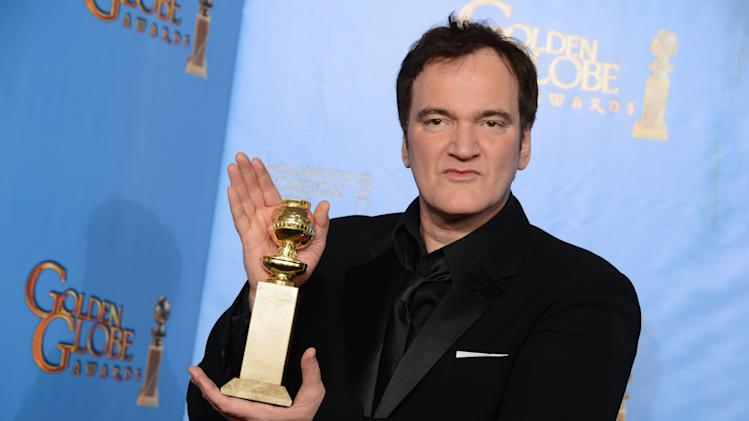 "Quentin Tarantino poses with the award for best screenplay for a motion picture for ""Django Unchained"" backstage at the 70th Annual Golden Globe Awards at the Beverly Hilton Hotel on Sunday Jan. 13, 2013, in Beverly Hills, Calif. (Photo by Jordan Strauss/Invision/AP)"