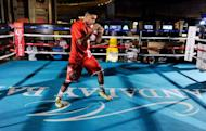 Boxer Amir Khan shadow boxes during a public workout session at the Mandalay Bay Resort & Casino in Las Vegas, Nevada. Khan will take on Danny Garcia for the WBC super lightweight world championship on July 14 in Las Vegas