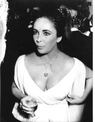 """Elizabeth Taylor attends a charity ball in Monaco, South of France on Nov. 17, 1969. Making its debut is the famous 69.42 carat, pear-shaped diamond that Taylor is wearing as a pendant. It is a present from her husband, Richard Burton. Initially, the diamond was bought by Paris jeweler Cartier at an auction and he named it """"Cartier."""" Burton bought it the next day and renamed it """"Taylor-Burton."""" (AP Photo/Maestri)"""