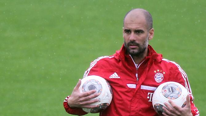 Bayern Munich head coach Pep Guardiola participates in a training session at the ASPIRE Academy for Sports Excellence in Doha, Qatar, Saturday, Jan. 11, 2014