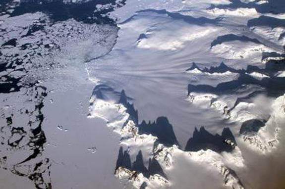 Several glaciers in the Antarctic Peninsula pass between sharp mountain peaks and converge in a single calving front, as seen by Operation IceBridge while returning from a survey of the Ronne Ice Shelf on Nov. 1, 2012. NASA's Operation IceBridg