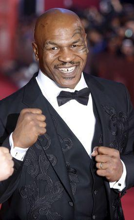 Former heavyweight boxing world champion Mike Tyson arrives at the 18th Shanghai International Film Festival