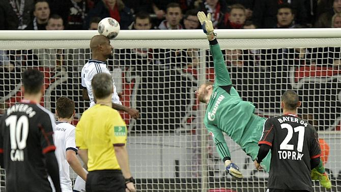 Schalke's Felipe Santana of Brazil, left, saves the ball on the goal line during  the German Bundesliga soccer match between Bayer Leverkusen and FC Schalke 04 in Leverkusen,  Germany, Saturday, Feb. 15, 2014. Leverkusen was defeated by Schalke with 1-2