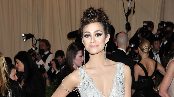 "Emmy Rossum attends The Metropolitan Museum of Art's Costume Institute benefit celebrating ""PUNK: Chaos to Couture"" on Monday May 6, 2013 in New York. (Photo by Charles Sykes/Invision/AP)"