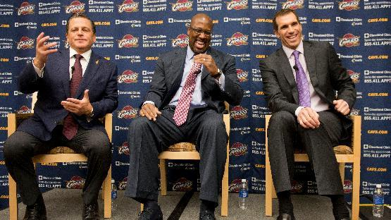 In this April 24, 2013 file photo, Cleveland Cavaliers owner Dan Gilbert, left, gestures as new head coach Mike Brown, center, and general manager Chris Grant laugh during an NBA basketball news conference in Independence, Ohio.The flailing Cavaliers fired general manager Chris Grant, Thursday, Feb. 6, 2014. With the Cavs sliding further toward the bottom in another disappointing season, owner Dan Gilbert decided to make the move a day after Cleveland was beaten Wednesday night by an injury-ravaged Los Angeles Lakers team that finished the game with just five players