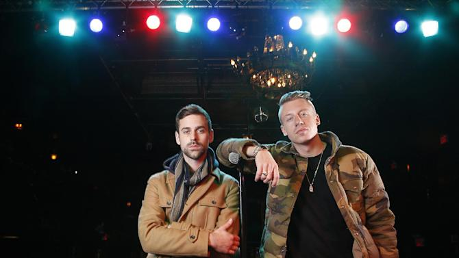 "FILE - In this Nov. 20, 2012 file photo, American musician Ben Haggerty, better known by his stage name Macklemore (R), and his producer Ryan Lewis pose for a portrait at Irving Plaza in New York.  Macklemore & Ryan Lewis feat. Wanz, ""Thrift Shop"" (Macklemore) is the number one top streamed track for the United States on Spotify from Monday, Jan. 28, to Sunday, Feb. 3, 2013. (Photo by Carlo Allegri/Invision/AP, File)"