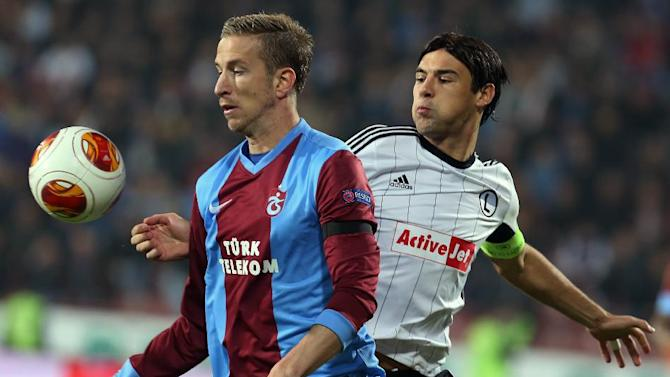 Trabzonspor's Janko, left, and Vrdoljak of Legia fight for the ball during their Europa League Group J soccer match in Trabzon, Turkey, Thursday Oct. 24, 2013. (AP Photo)