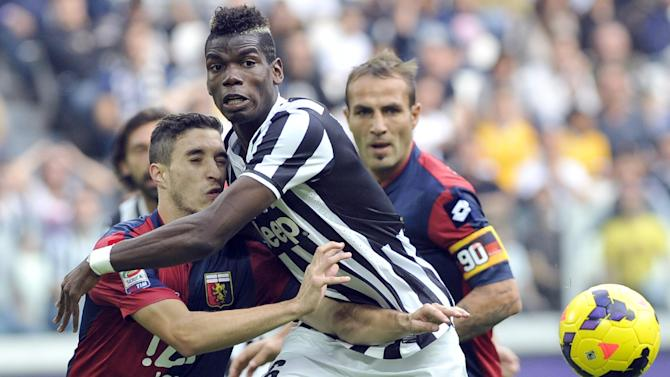 Juventus midfielder Paul Pogba, of France, center, is challenged by Genoa Sime Vrsaljko, of Slovakia, during a Serie A soccer match at the Juventus stadium, in Turin, Italy, Sunday, Oct. 27, 2013