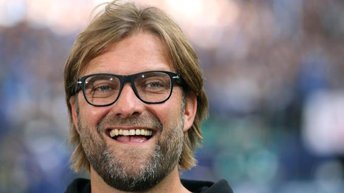 In this Oct. 26 2013 file picture Dortmund's head coach Juergen Klopp  laughs  prior to the German Bundesliga soccer match between FCSchalke 04 and Borussia Dortmund  Gelsenkirchen, Germany. Coach Juergen Klopp has signed a two-year contract extension with Borussia Dortmund Wednesday Oct. 30, 2013 that keeps him at the club until June 2018. Klopp took over at Dortmund in 2008. He guided the team to back-to-back Bundesliga titles in 2011 and 2012, won the German Cup in 2012 and reached the Champions League final last season. Dortmund is currently second in the Bundesliga, one point behind defending champion Bayern Munich 10 matches into the season