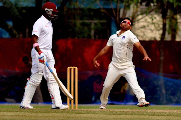 Piyush Chawla in action during a practice match between Uttar Pradesh Cricket Association XI and West Indies at the Jadavpur University Ground in Kolkata on Oct.31, 2013. (Photo: IANS)