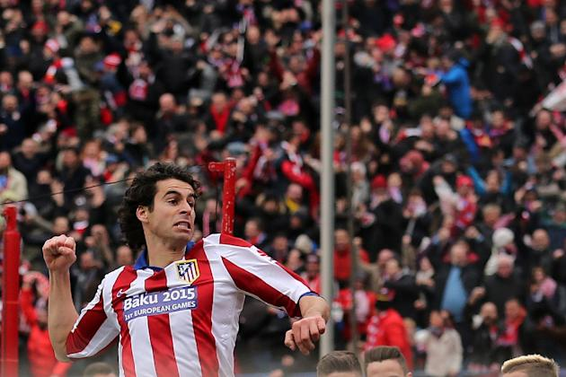 Atletico Madrid's Portuguese midfielder Tiago celebrates after scoring during the Spanish league football match Club Atletico de Madrid vs Real Madrid CF at the Vicente Calderon stadium in Madrid