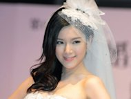 Christine Kuo has no partner to practice Cantonese