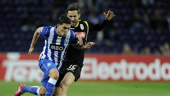 FC Porto's Juan Quintero, from Colombia, drives the ball past Arouca's Rui Sampaio in a Portuguese League soccer match at the Dragao stadium, in Porto, Portugal, Sunday, March 9, 2014. Porto won 4-1