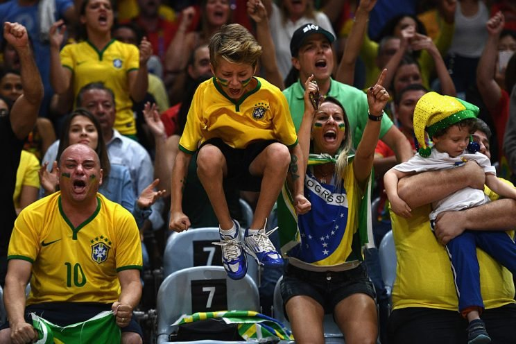 RIO DE JANEIRO, BRAZIL - AUGUST 17: Fans of Brazil cheer on their team during the Women's Quarterfinal match between China and Brazil on day 11 of the Rio 2106 Olympic Games at the Maracanazinho on August 17, 2016 in Rio de Janeiro, Brazil. (Photo by David Ramos/Getty Images)