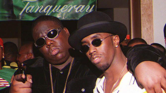 "**FILE**In this March 8, 1997 file photo, Notorious B.I.G., whose real name is Christopher Wallace, left, gestures as he and producer Sean ""Diddy"" Combs leave a party at the Petersen Automotive Museum in Los Angeles late Saturday evening, shortly before Wallace was shot to death. Authorities have unsealed an autopsy report the week of Nov. 26, 2012 showing that rapper Notorious B.I.G. was shot four times in a 1997 drive-by shooting that remains unsolved. (AP Photo/Venus Bernardo-Prudhomme, File)"
